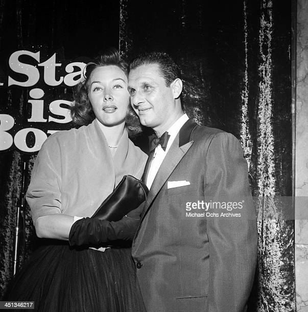"Actress Gloria Grahame with Cy Howard attends a party for""A Star Is Born"" in Los Angeles, California."