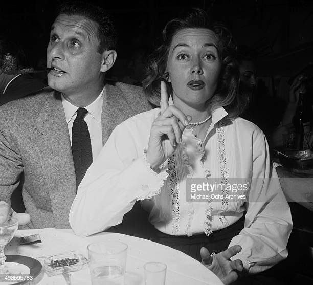 Actress Gloria Grahame with Cy Howard attends a party in Los Angeles California