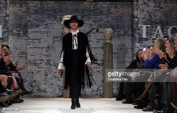Actress Gloria Guida walks the runway at the Gattinoni show during Altaroma on January 27, 2018 in Rome, Italy.