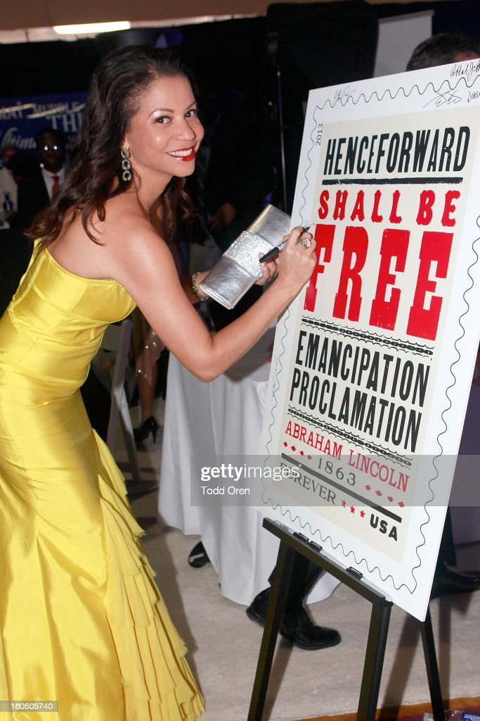 Actress Gloria Reuben previews the Emancipation Proclamation Forever Stamp in the U.S. Postal Service Civil Rights Stamp Gallery backstage at the NAACP Image Awards on February 1, 2013 at The Shrine Auditorium.