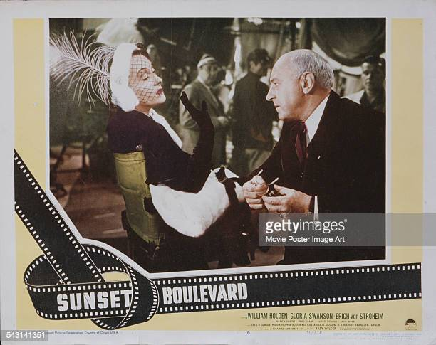 Actress Gloria Swanson and director Cecil B DeMille appear on a poster for the Paramount Pictures film 'Sunset Boulevard' 1950