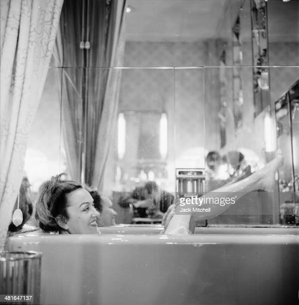 Actress Gloria Swanson photographed in her bathtub in New York City in 1960