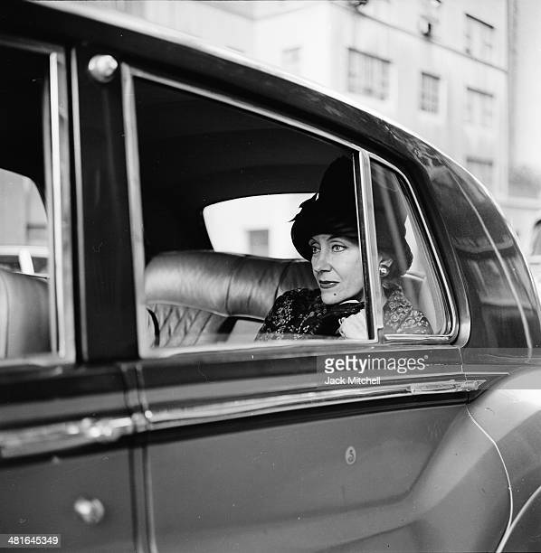Actress Gloria Swanson photographed in her chauffeur driven Rolls Royce in New York City in 1960