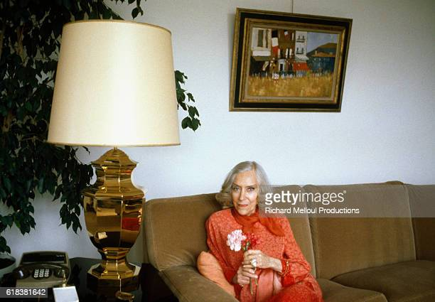 Actress Gloria Swanson Sitting in Living Room