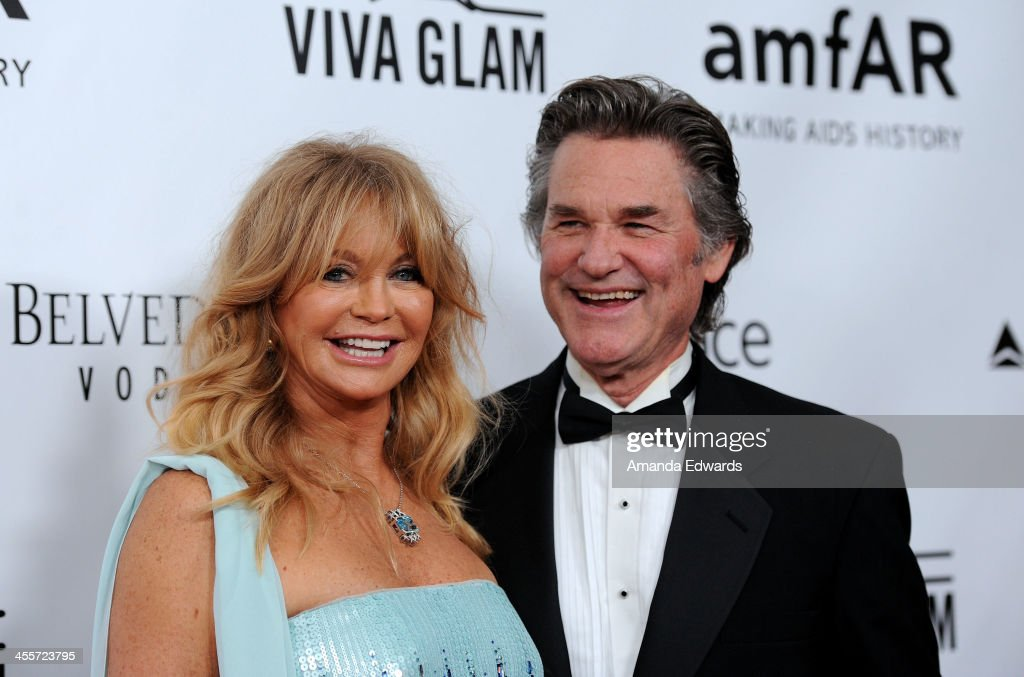 Actress Goldie Hawn (L) and actor Kurt Russell arrive at amfAR The Foundation for AIDS 4th Annual Inspiration Gala at Milk Studios on December 12, 2013 in Hollywood, California.