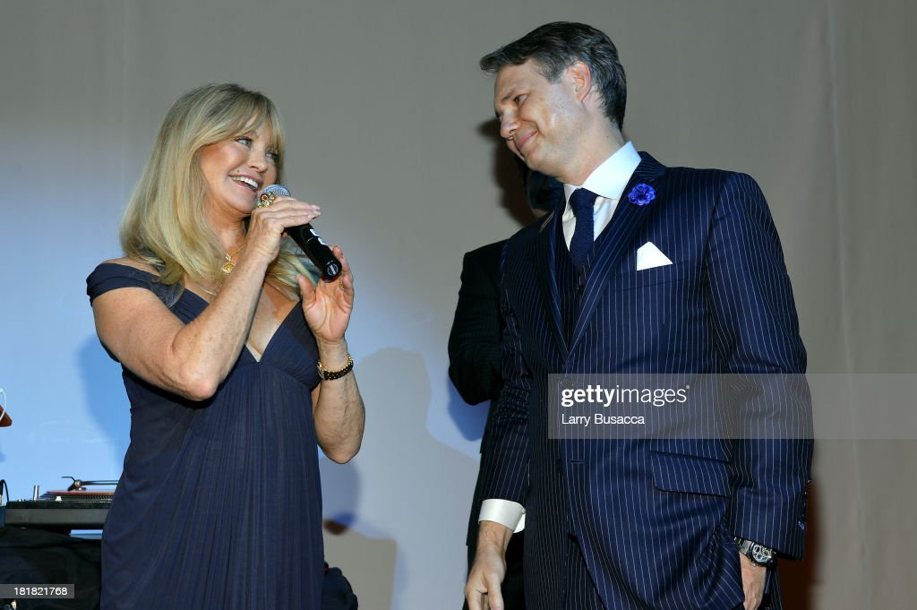 Actress Goldie Hawn and Jason Binn speak onstage at DuJour's Jason Binn and Kurt Russell's celebration of Goldie Hawn and The Hawn Foundation at Espace on September 25, 2013 in New York City.