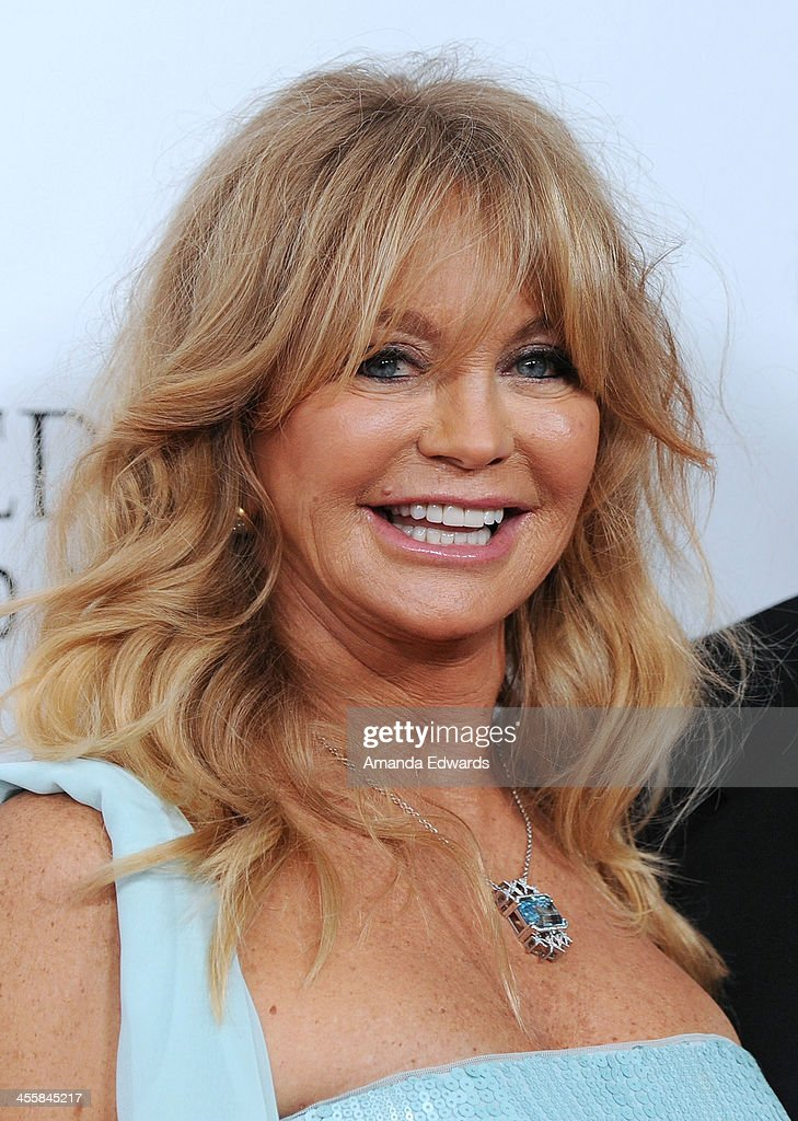 Actress Goldie Hawn arrives at amfAR The Foundation for AIDS 4th Annual Inspiration Gala at Milk Studios on December 12, 2013 in Hollywood, California.