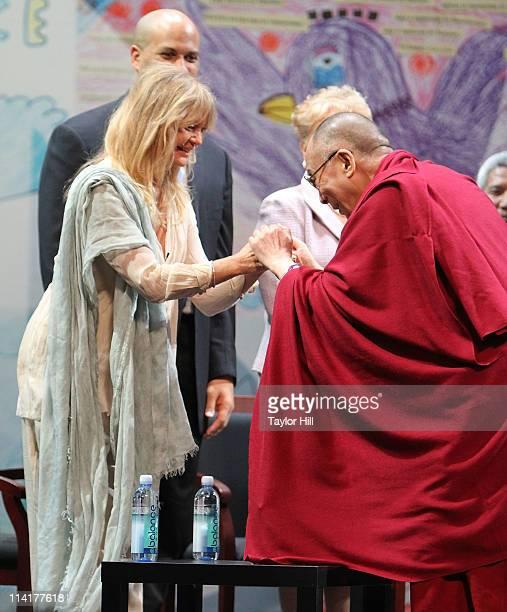 Actress Goldie Hawn greets the Dalai Lama at the Newark Peace Education Summit at New Jersey Performing Arts Center on May 14 2011 in Newark New...