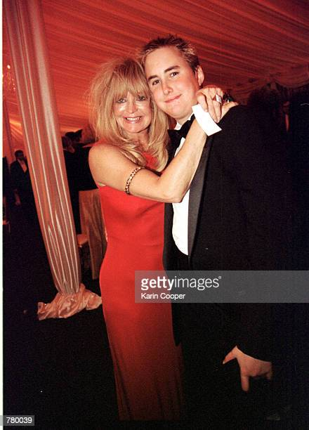 Actress Goldie Hawn hugs Boston Russell son of her companion Kurt Russell at the White House for an official dinner honoring Indian Prime Minister...