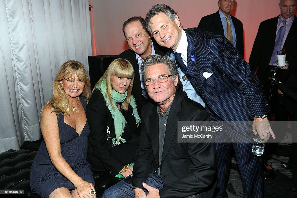 Actress Goldie Hawn, Marcy Warren, Michael Warren, Jason Binn and actor Kurt Russell attend DuJour's Jason Binn and Kurt Russell's celebration of Goldie Hawn and The Hawn Foundation at Espace on September 25, 2013 in New York City.
