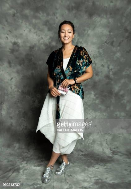 TOPSHOT Actress Gong Li poses during the opening night of the 2018 COLCOA French Film Festival April 23 2018 at the Directors Guild of America...