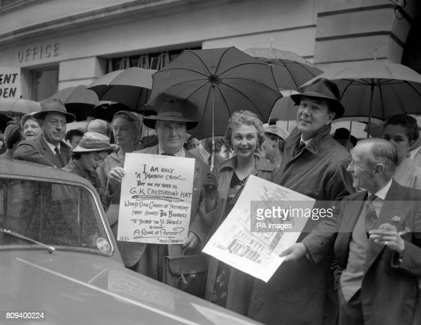 Actress Googie Withers and actor Michael Redgrave, second right, with dramatic critic Alan Dent , as a procession assembled outside the St James's...
