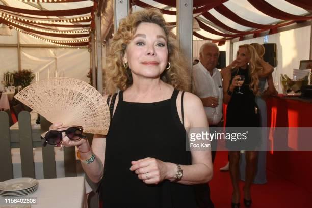 Actress Grace de Capitani attends The Children for Peace Auction Diner at Jardin des Tuileries on June 25 2019 in Paris France