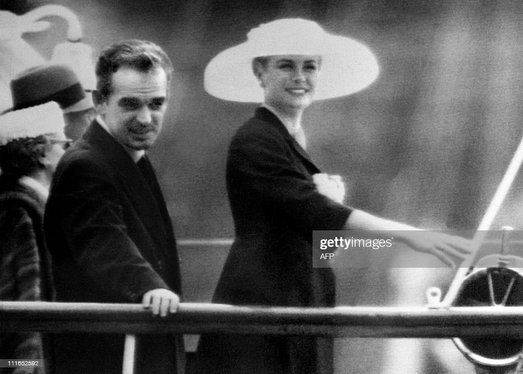 US actress Grace Kelly (R) and Prince Rainier III of Monaco (L) arrive in Monaco Bay aboard the princely yacht 'Deo Juvante II' , on April 12, 1956 after Grace Kelly crossed the Atlantic Ocean for her wedding ceremony with the Prince, planned on April 12, 1956.