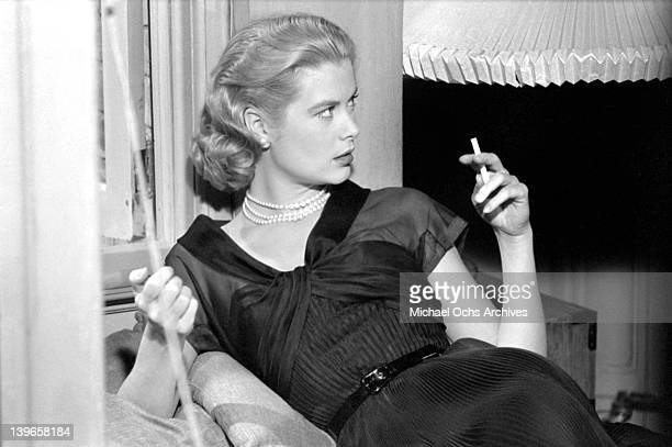Actress Grace Kelly takes a break on the set of the Paramount Pictures movie 'Rear Window' in November 1953 in Los Angeles California