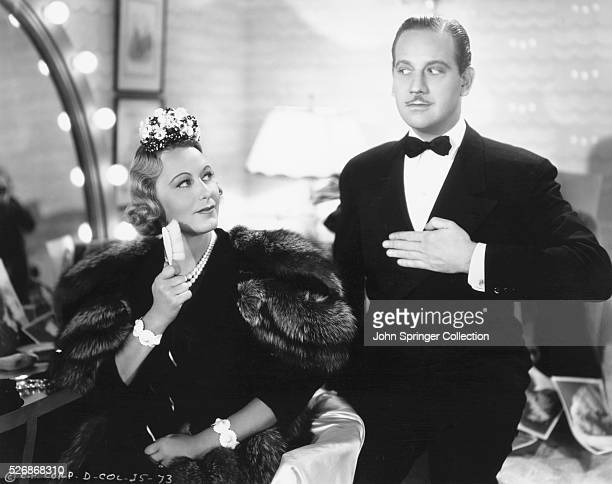 Actress Grace Moore stars as singer Elsa Terry and actor Melvyn Douglas stars as James Guthrie in a scene from the 1937 musical I'll Take Romance In...