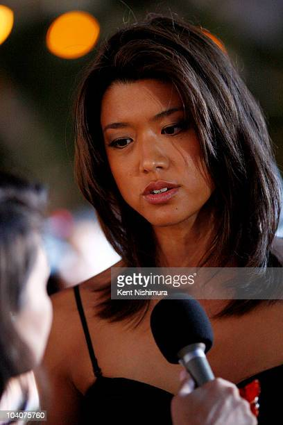 Actress Grace Park arrives at Sunset on the Beach on Waikiki Beach for a screening of the highlyanticipated 'Hawaii 50' series premiere on September...