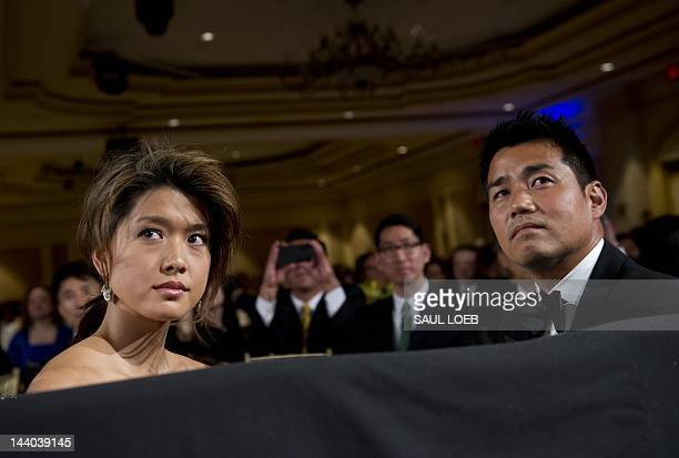 Actress Grace Park from television's Hawaii Five-O listens as US President Barack Obama speaks during the Asian Pacific American Institute for...