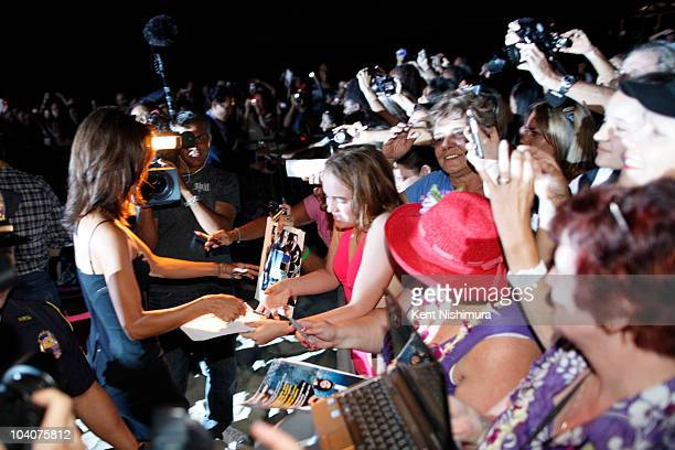 Actress Grace Park signs autographs at Sunset on the Beach at Waikiki Beach for a screening of the highlyanticipated series premiere of the CBS show...