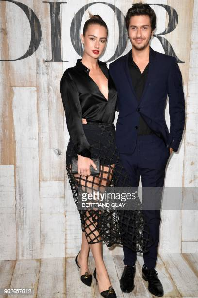 US actress Grace Van Patten poses with a guest during the photocall before the 2019 Dior Croisiere fashion show on May 25 2018 at the Grandes écuries...