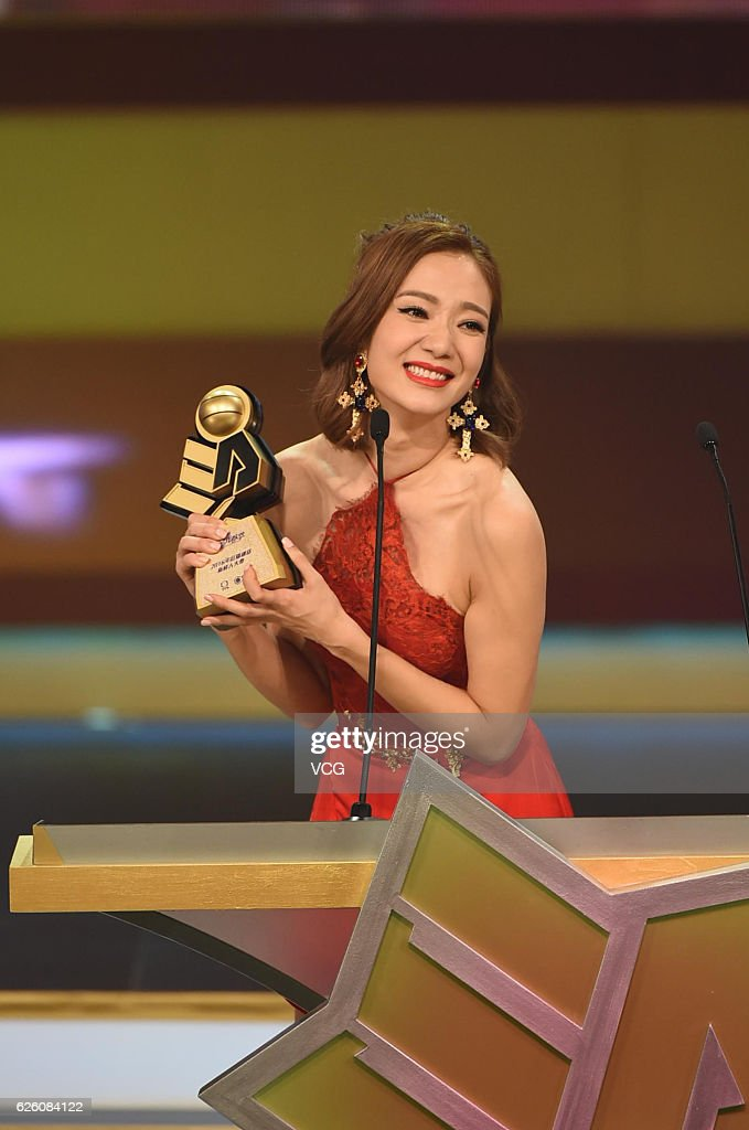 Actress Grace Wong Kwan-hing poses with her trophy during ...