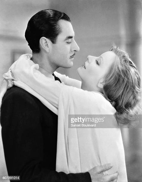 Actress Greta Garbo and actor John Gilbert on the set of A Woman Affairs