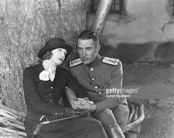 Actress Greta Garbo and actor John Gilbert on the set of Love