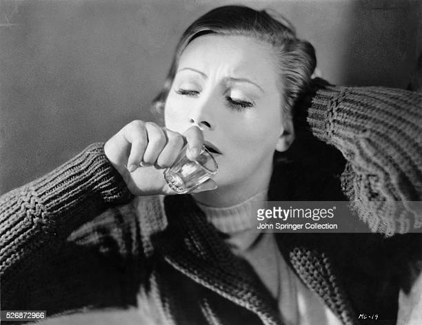 Actress Greta Garbo Holding Shot Glass