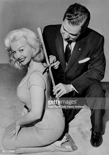 Actress Greta Thyssen as she is measured with distortion analyzer by Dr Vincent J O'Neill President of Chiropractic Association of New York State...