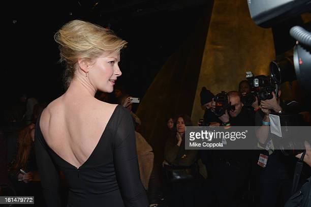 Actress Gretchen Mol attends the Donna Karan New York Fall 2013 fashion show during MercedesBenz Fashion Week at 547 W 26th Street on February 11...