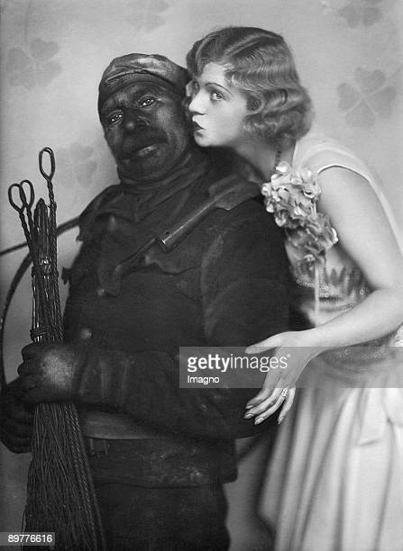 Actress Grete Theimer kissing a chimney sweeper Photograph Around 1930