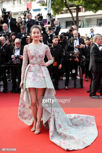 Actress Guan Xiaotong arrives on the red carpet of the 70th Anniversary dinner during the 70th annual Cannes Film Festival at Palais des Festivals on...