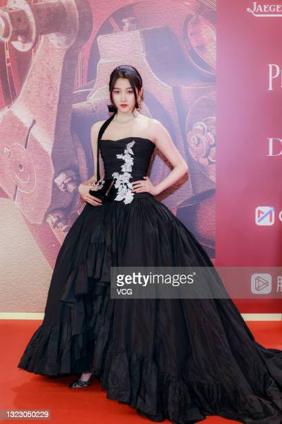 Actress Guan Xiaotong attends opening ceremony of the 24th Shanghai International Film Festival at Shanghai Grand Theatre on June 11, 2021 in...