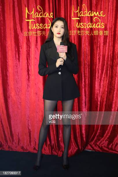 Actress Guan Xiaotong attends the unveiling ceremony of her wax figure at Madame Tussauds Beijing on July 5, 2021 in Beijing, China.