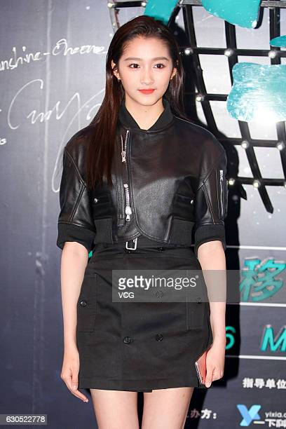 Actress Guan Xiaotong poses at the carpet of the 2016 Mobile Video Festival at Beijing National Aquatics Center on December 25 2016 in Beijing China