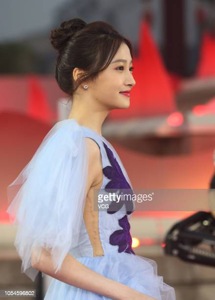 XI'AN CHINA OCTOBER 13 Actress Guan Xiaotong poses on the red carpet during the closing ceremony of the 5th Silk Road International Film Festival at...