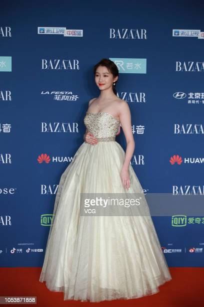 Actress Guan Xiaotong poses on the red carpet of 2018 Bazaar Star Charity Night on October 12 2018 in Beijing China
