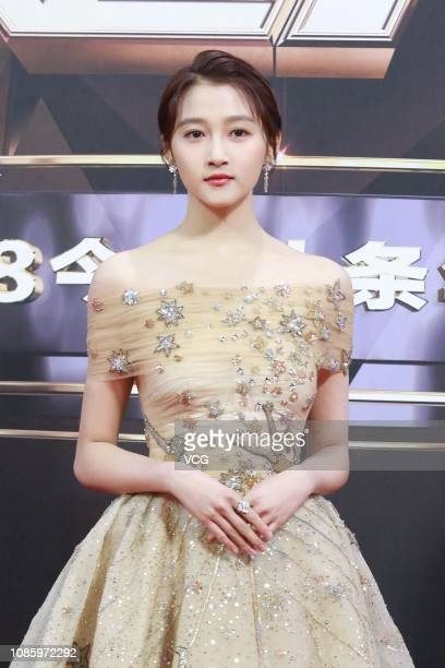 Actress Guan Xiaotong poses on the red carpet of 2018 Toutiao Awards Ceremony at the Beijing National Aquatics Center on December 23 2018 in Beijing...