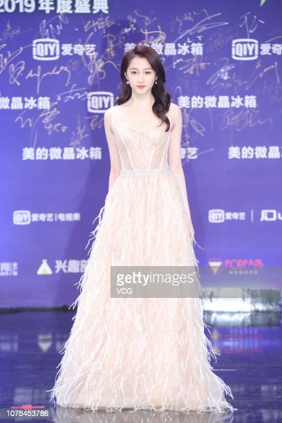 Actress Guan Xiaotong poses on the red carpet of 2019 iQiyi Allstar Carnival on December 1 2018 in Beijing China