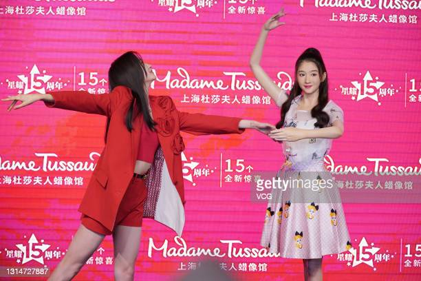Actress Guan Xiaotong poses with her wax figure during the unveiling ceremony at Madame Tussauds Shanghai on April 26, 2021 in Shanghai, China.