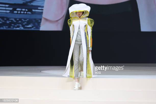 Actress Guan Xiaotong showcases designs during the Chinese Olympic Team Tokyo 2020 Uniform Unveiling at Yanxi Lake on June 25, 2021 in Beijing, China.