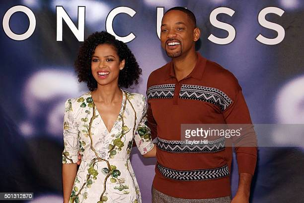 """Actress Gugu Mbatha-Raw and actor Will Smith attends a photocall for """"Concussion"""" at Crosby Street Hotel on December 14, 2015 in New York City."""