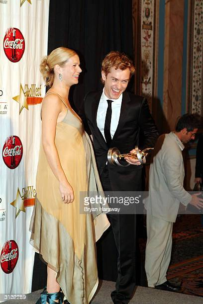 Actress Gwyneth Paltrow and Actor Jude Law hold their awards for 'Distinguished Decade of Achievement in Film' and 'Male Star of the Year'...