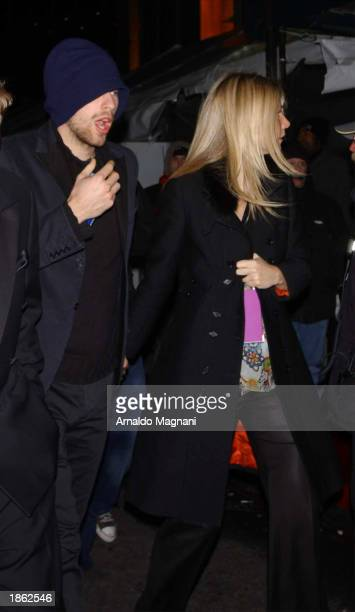 Actress Gwyneth Paltrow and boyfriend musician Chris Martin of Coldplay leave Madison Square Garden after the 45th Annual Grammy Awards on February...
