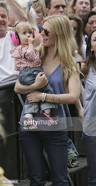 "Actress Gwyneth Paltrow and daughter Apple watch Coldplay singer Chris Martin perform on stage at ""Live 8 London"" in Hyde Park on July 2, 2005 in..."