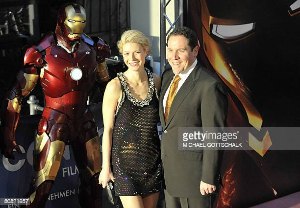 US actress Gwyneth Paltrow and US director Jon Favreau arrive for the screening of their movie Iron Man on April 22 2008 in Berlin The US movie...
