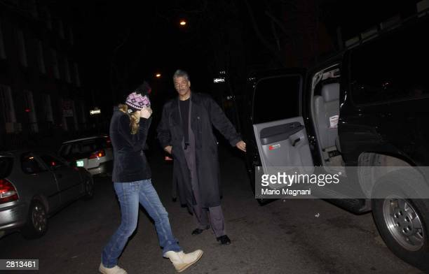 Actress Gwyneth Paltrow covers her face as she leaves her apartment and enters a car December 15 2003 in New York City Her new husband musician Chris...