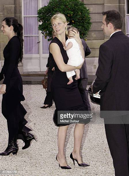 Actress Gwyneth Paltrow holds her baby, Apple Martin, as they attend the ceremony where director Steven Spielberg was awarded the Chevalier de la...