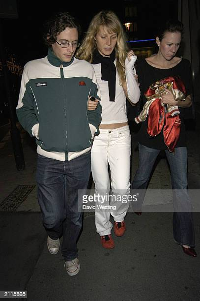 Actress Gwyneth Paltrow leaves Signor Sassi restaurant with unidentified friends after having dinner with her boyfriend Chris Martin lead singer of...
