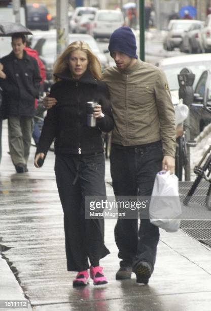 Actress Gwyneth Paltrow walks with her boyfriend musician Chris Martin of Coldplay February 23 2003 in New York City